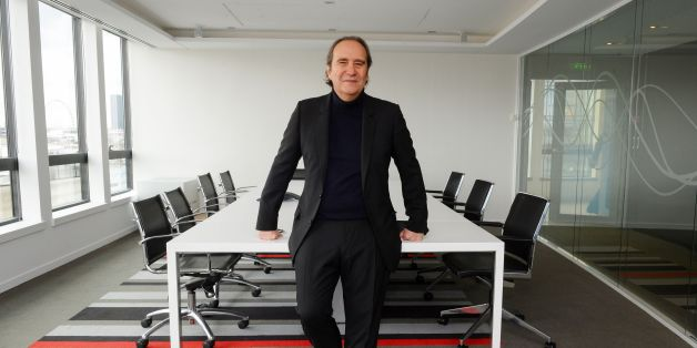 French telecom Iliad Group founder and Vice President Xavier Niel poses prior to a press conference to present the group's 2016 results on March 7, 2017 at the group's headquarters in Paris. / AFP PHOTO / ERIC PIERMONT        (Photo credit should read ERIC PIERMONT/AFP/Getty Images)