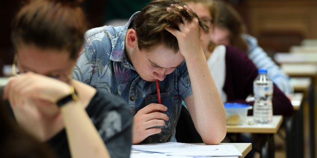 High school students take the philosophy exam, the first test session of the 2017 baccalaureate (high school graduation exam) on June 15, 2017 at the Fustel de Coulanges high school in Strasbourg, eastern France. A total of 520.000 Students of general and technological graduating classes  are registered to take their written baccalaureat exams at over 4 400 examination centres across France between June 15-June 22, 2017. / AFP PHOTO / FREDERICK FLORIN        (Photo credit should read FREDERICK F