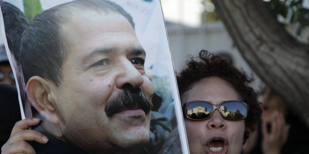 A Moroccan woman holds a picture of slain Tunisian secular opposition politician Chokri Belaid during a demonstration in front of the Tunisian embassy in Rabat February 8, 2013. REUTERS/Stringer (MOROCCO - Tags: CIVIL UNREST POLITICS CRIME LAW)