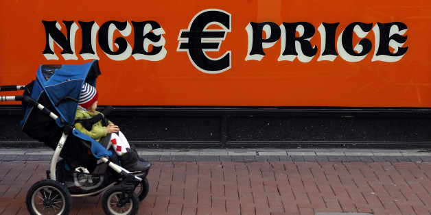 A pram is pushed past a discount store in central Dublin November 14, 2010. The European Union is not putting pressure on Ireland to apply for emergency assistance and there are no discussions about a bailout, the Irish minister for enterprise, trade and innovation said on Sunday.     REUTERS/Cathal McNaughton (IRELAND - Tags: BUSINESS POLITICS))