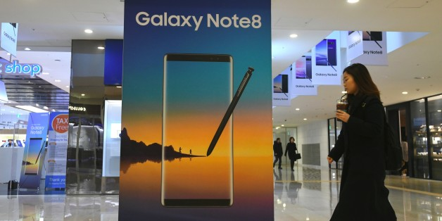 A woman walks past an advertisement for the Samsung Galaxy Note 8 at the company's showroom in Seoul on January 31, 2018.Samsung Electronics reported a 73 percent jump in its fourth quarter net profit on January 31, setting a record for any three-month period, mainly driven by demand for its memory chips and display panels. / AFP PHOTO / JUNG Yeon-Je        (Photo credit should read JUNG YEON-JE/AFP/Getty Images)