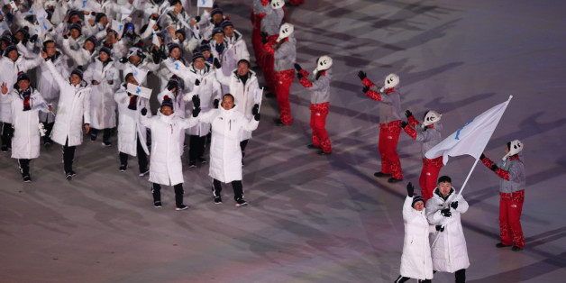 PYEONGCHANG-GUN, SOUTH KOREA - FEBRUARY 09:  The North Korea and South Korea Olympic teams enter together under the Korean Unification Flag during the Parade of Athletes during the Opening Ceremony of the PyeongChang 2018 Winter Olympic Games at PyeongChang Olympic Stadium on February 9, 2018 in Pyeongchang-gun, South Korea.  (Photo by Dan Istitene/Getty Images)