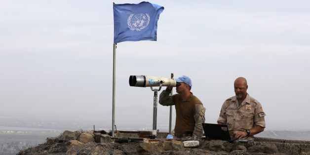 UN soldiers look out on a post at Mount Avital, in the Israeli-occupied Golan Heights near the Israeli Syrian border, Israel February 10, 2018. REUTERS/Ammar Awad
