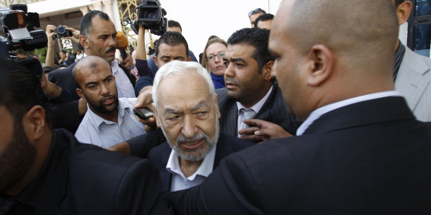 Rached Ghannouchi (C), leader of Ennahda Party, speaks to the media after a meeting, as part of a dialogue between ruling Islamists and the opposition, which aims to pave the way for the formation of a transitional government, in Tunis November 2, 2013.   REUTERS/Zoubeir Souissi (TUNISIA - Tags: POLITICS)