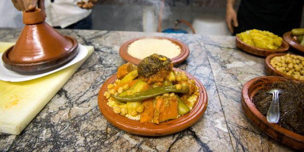 A Moroccan chef prepares a traditional couscous dish in a restaurant in the capital Rabat on January on february 9, 2018. / AFP PHOTO / FADEL SENNA        (Photo credit should read FADEL SENNA/AFP/Getty Images)