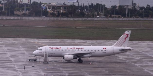 A picture taken on October 15, 2015, shows a Tunisair plane parked on a tarmac at Tunis-Carthage International in Tunis. / AFP PHOTO / FETHI BELAID        (Photo credit should read FETHI BELAID/AFP/Getty Images)