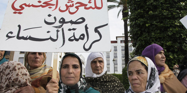 "Women from various regions of Morocco hold placards as they protest against violence towards women, in Rabat November 24, 2013. The placard reads, ""Stopping harassment gives dignity for women"".   REUTERS/Youssef Boudlal   (MOROCCO - Tags: CIVIL UNREST SOCIETY POLITICS)"