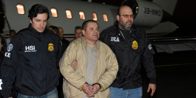 "FILE PHOTO: Mexico's top drug lord Joaquin ""El Chapo"" Guzman is escorted as he arrives at Long Island MacArthur airport in New York, U.S., January 19, 2017, after his extradition from Mexico. Picture taken Janaury 19, 2017.  U.S. officials/Handout via REUTERS      ATTENTION EDITORS - THIS IMAGE WAS PROVIDED BY A THIRD PARTY. EDITORIAL USE ONLY./File Photo"