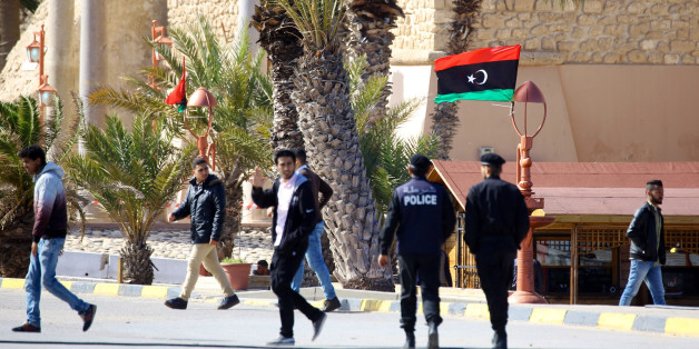 Libyans walk in Tripoli's Martyr square on February 15, 2018, two days ahead of the seventh anniversary of the Libyan revolution, which toppled strongman Moamer Kadhafi. / AFP PHOTO / MAHMUD TURKIA        (Photo credit should read MAHMUD TURKIA/AFP/Getty Images)