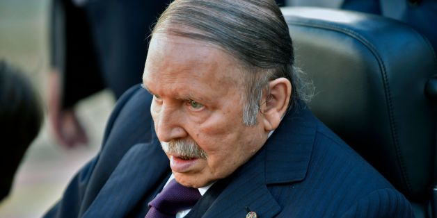 Algerian President Abdelaziz Bouteflika is seen heading to vote at a polling station in Algiers on November 23, 2017 as Algeria goes to the polls for local elections. / AFP PHOTO / RYAD KRAMDI        (Photo credit should read RYAD KRAMDI/AFP/Getty Images)