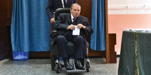Algerian President Abdelaziz Bouteflika is seen on a wheelchair as he votes at a polling station in Algiers on May 4, 2017. 
