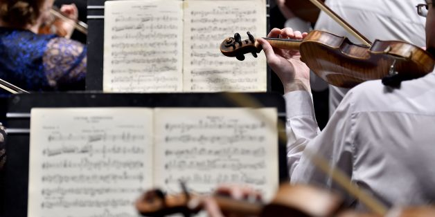 Musicians of the Ural Philharmonic Orchestra (Orchestre Philharmonique de l'Oural) rehearse the violin part of a musical piece composed by Russian composer Sergei Rachmaninoff and leaded by Russian director Dmitri Liss on the first day of 'La Folle Journee de Nantes' classic music festival, on January 31, 2018 in Nantes, western France. / AFP PHOTO / LOIC VENANCE        (Photo credit should read LOIC VENANCE/AFP/Getty Images)