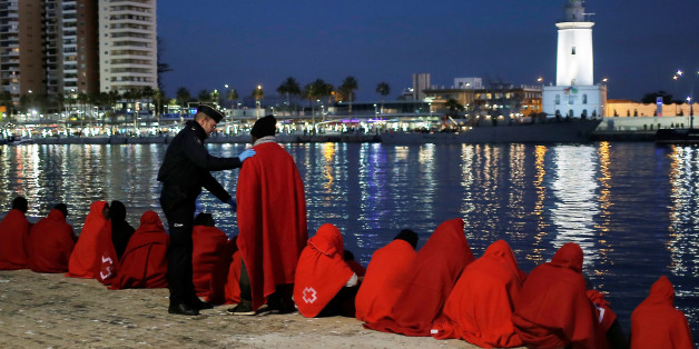 A migrant, part of a group intercepted aboard a dinghy off the coast in the Mediterranean Sea, talks to a Spanish police officer after arriving on a rescue boat at the Port of Malaga, Spain December 7, 2017. REUTERS/Jon Nazca