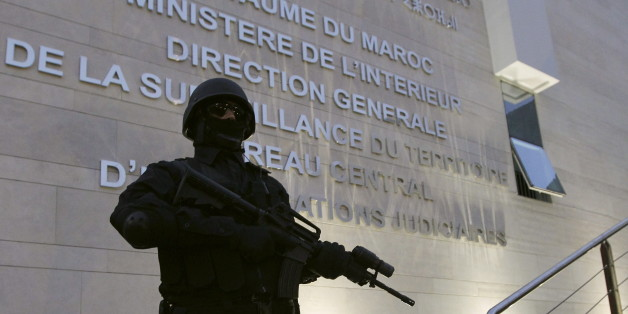 A Moroccan policeman stands guard at the Central Bureau of Judicial Investigation office in Sale, March 23, 2015. Moroccan authorities said on Monday they had dismantled a militant cell planning to create an Islamic State affiliate in the North African kingdom, seizing guns and accusing its members of plotting attacks. Reporters were shown six pistols and ammunition seized from a hideout near the southern city of Agadir, in the offices of the BCIJ in the city of Sale. REUTERS/Stringer