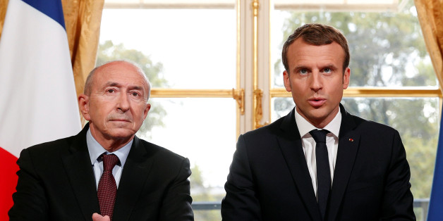 French President Emmnauel Macron (R) addresses the medias with French Interior Minister Gerard Collomb (L) after signing a new anti-terrorism and interior security law at the Elysee Palace in Paris, France, October 30, 2017. REUTERS/Christophe Ena/Pool