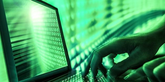 closeup laptop hacker hands