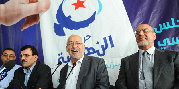 Leader and founder of Ennahdha Islamist movement, Rached Ghannouchi (C), flanked by his general secretary Hamadi Jebali (R) and Ennahdha Assembly President Ali Laaraiedh (L), gives a press conference on October 19, 2011 in Ariana near Tunis. Tunisia's first post-revolution polls risk being rigged, the Islamist party leading opinion polls warned Wednesday, vowing a fresh uprising if vote was marred by fraud. 'There is a risk of the election results being manipulated,' Ennahda leader Rached Ghanno