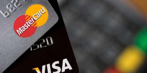 Bangkok, Thailand - May 24, 2016: Closeup of VISA and MASTER credit cards on the credit card machine.
