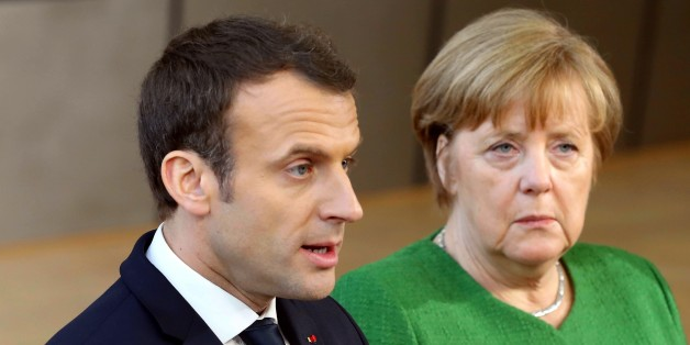 BRUSSELS, BELGIUM - FEBRUARY 23: German Prime Minister Angela Merkel (R) and French President Emmanuel Macron (L) answer the questions of press members as they arrive to attend the EU members' informal meeting of the 27 heads of state or government at European Council headquarters in Brussels, Belgium on February 23, 2018. (Photo by Dursun Aydemir/Anadolu Agency/Getty Images)