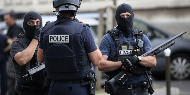 French police and anti-crime brigade (BAC) secure a street they carried out a counter-terrorism swoop at different locations in Argenteuil, a suburb north of Paris, France, July 21, 2016. REUTERS/Charles Platiau