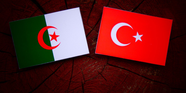 Algerian flag with Turkish flag on a tree stump isolated