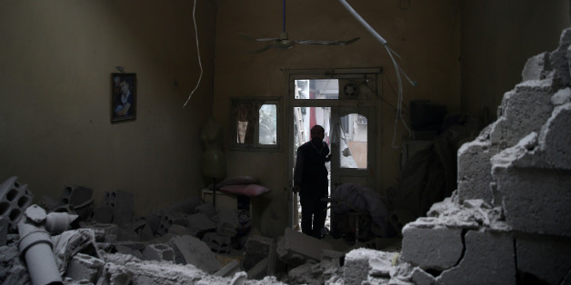 A man inspects a damaged house in the besieged town of Douma in eastern Ghouta in Damascus, Syria, February 22, 2018. REUTERS/Bassam Khabieh