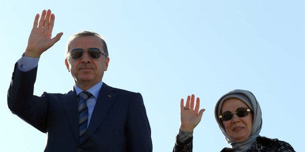 ALGIERS, ALGERIA - NOVEMBER 20: Turkish President Recep Tayyip Erdogan and First Lady Emine Erdogan greet the Algerian officials during their departure from Algeria to go Equatorial Guinea for the Second Turkey-Africa Partnership Summit, in Algiers on November 20, 2014. (Photo by Kayhan Ozer/Anadolu Agency/Getty Images)