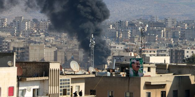 Smoke is seen billowing from the northern Syrian Kurdish town of Afrin on January 31, 2018. Turkey and allied Syrian rebel groups launched operation Olive Branch on January 20 against the Kurdish People's Protection Units (YPG), which controls the Afrin region.  / AFP PHOTO / Ahmad Shafie BILAL        (Photo credit should read AHMAD SHAFIE BILAL/AFP/Getty Images)