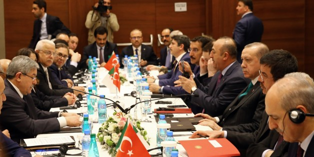 ALGIERS, ALGERIA - FEBRUARY 26: President of Turkey Recep Tayyip Erdogan (R) accompanied by Turkish Foreign Minister Mevlut Cavusoglu (right 4), Turkish Economy Minister Nihat Zeybekci (right 2), Turkey's Customs and Trade Minister Bulent Tufenkci (right 6) and Turkey's Energy and Natural Resources Minister Berat Albayrak (right 5) meets Prime Minister of Algeria Ahmed Ouyahia (L) in Algiers, Algeria on February 26, 2018. (Photo by Halil Sagirkaya/Anadolu Agency/Getty Images)