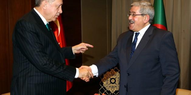 ALGIERS, ALGERIA - FEBRUARY 26: President of Turkey Recep Tayyip Erdogan (L) shakes hands with Prime Minister of Algeria Ahmed Ouyahia (R) during their meeting in Algiers, Algeria on February 26, 2018. (Photo by Kayhan Ozer/Anadolu Agency/Getty Images)