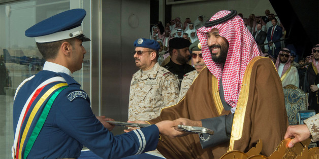 A cadet of King Faisal Air Academy receives a sword from Saudi Arabia's Crown Prince Mohammed bin Salman during a graduation ceremony in Riyadh, Saudi Arabia, February 21, 2018. Bandar Algaloud/Courtesy of Saudi Royal Court/Handout via REUTERS ATTENTION EDITORS - THIS PICTURE WAS PROVIDED BY A THIRD PARTY.