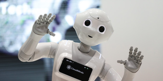 A SoftBank Group Corp. Pepper humanoid robot stands on display during day two of the Mobile World Congress (MWC) in Barcelona, Spain, on Tuesday, Feb. 27, 2018. At the wireless industry's biggest conference, more than 100,000 people are set to see the latest smartphones, artificial intelligence devices and autonomous drones exhibited by roughly 2,300 companies. Photographer: Simon Dawson/Bloomberg via Getty Images