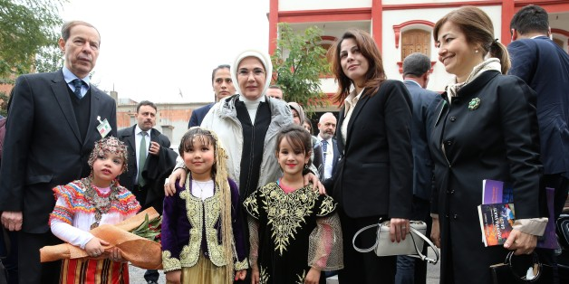 ALGIERS, ALGERIA - FEBRUARY 27: (----EDITORIAL USE ONLY MANDATORY CREDIT - 'TURKISH PRESIDENCY / MURAT CETINMUHURDAR / HANDOUT' - NO MARKETING NO ADVERTISING CAMPAIGNS - DISTRIBUTED AS A SERVICE TO CLIENTS----) President of Turkey Recep Tayyip Erdogan's wife Emine Erdogan (C) poses for a photo with kids during an opening ceremony of a preschool and a park belonging to FOREM Foundation, that were renovated by Turkish Cooperation and Coordination Agency (TIKA) and named after Emine Erdogan, in Alg