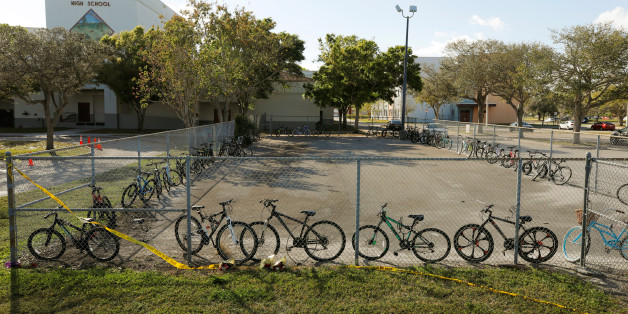 Bicycles used to go to school on the day of the shooting at Marjory Stoneman Douglas High School remain on campus four days after the event in Parkland, Florida, U.S. February 18, 2018.   REUTERS/Jonathan Drake