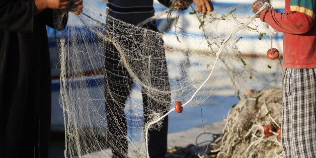 Djerba fishermen tending nets, Tunisia. (Photo by: Godong/UIG via Getty Images)