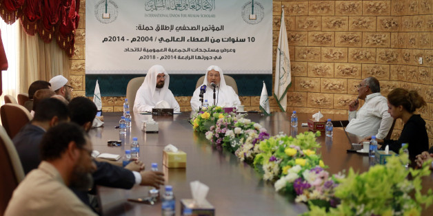 Chairman of the International Union of Muslim Scholars Youssef al-Qaradawi (3rd R) speaks during a news conference in Doha June 23, 2014. The influential Sunni Muslim cleric said on Monday that only dialogue could solve Iraq's crisis, sounding a conciliatory note on the threat posed by Sunni Islamist insurgents that could further polarise the Middle East along sectarian lines. Picture taken June 23.     REUTERS/Mohammed Dabbous (QATAR - Tags: RELIGION POLITICS CIVIL UNREST)