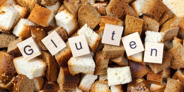 Slice of rusk bread with Gluten text concept.
