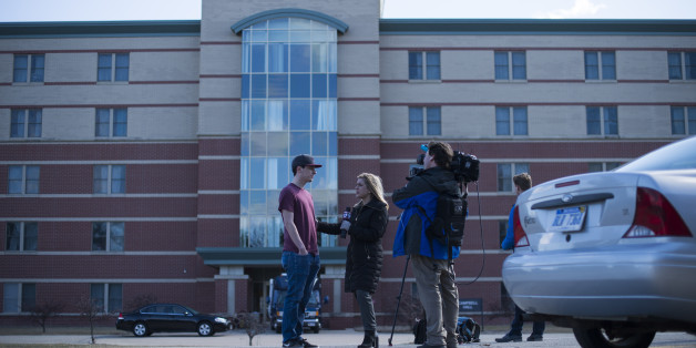 MOUNT PLEASANT, MI - MARCH 02: Tyler Whipple, a Central Michigan University student, is interviewed by the media outside of Campbell Hall, where a shooting took place at Central Michigan University on March 2, 2018 in Mount Pleasant, Michigan. Two people were killed in an on-campus shooting at Central Michigan University. The University is on lockdown as the police search for the suspect, a 19-year-old man. (Photo by Rachel Woolf/Getty Images)