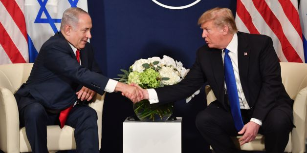 US President Donald Trump (R) shakes hands with Israel's Prime Minister Benjamin Netanyahu during a bilateral meeting on the sidelines of the World Economic Forum (WEF) annual meeting in Davos, eastern Switzerland, on January 25, 2018. / AFP PHOTO / Nicholas Kamm        (Photo credit should read NICHOLAS KAMM/AFP/Getty Images)