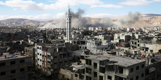 Smoke rises from the besieged Eastern Ghouta in Damascus, Syria, February 27, 2018. REUTERS/ Bassam Khabieh
