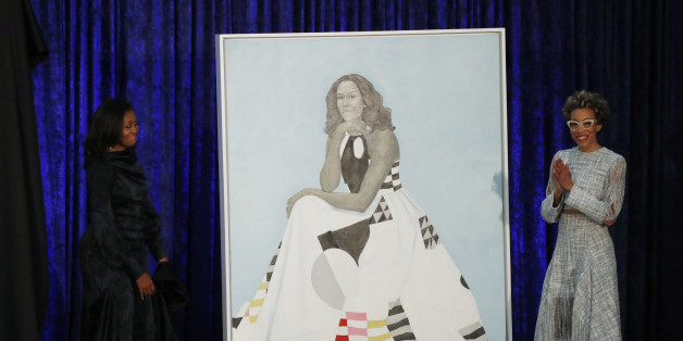 Artist Amy Sherald (R) and former first lady Michelle Obama participate in the unveiling of Mrs. Obama's portrait at the Smithsonian's National Portrait Gallery in Washington, U.S., February 12, 2018. REUTERS/Jim Bourg