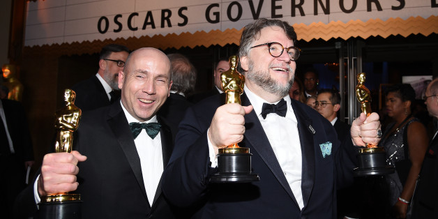 HOLLYWOOD, CA - MARCH 04: Filmmaker Guillermo del Toro (R), winner of the Best Director and Best Picture awards for 'The Shape of Water,' and producer J. Miles Dale, winner of the Best Picture award for 'The Shape of Water' attend the 90th Annual Academy Awards Governors Ball at Hollywood & Highland Center on March 4, 2018 in Hol ywood, California.  (Photo by Kevork Djansezian/Getty Images)