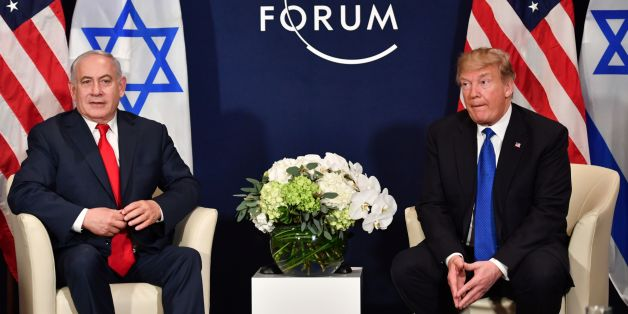 US President Donald Trump (R) speaks with Israel's Prime Minister Benjamin Netanyahu during a bilateral meeting on the sidelines of the World Economic Forum (WEF) annual meeting in Davos, eastern Switzerland, on January 25, 2018. / AFP PHOTO / Nicholas Kamm        (Photo credit should read NICHOLAS KAMM/AFP/Getty Images)