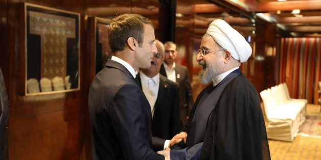 France's president Emmanuel Macron (L) greets Iranian president Hassan Rouhani at the Millennium Hotel near the United Nations on September 18, 2017, in New York. / AFP PHOTO / LUDOVIC MARIN        (Photo credit should read LUDOVIC MARIN/AFP/Getty Images)