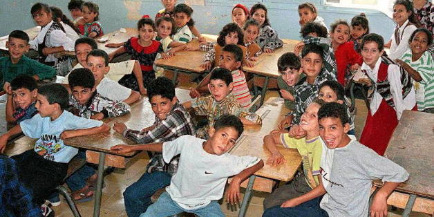 BOUFARIK, ALGERIA:  Algerian schoolchildren attend 09 September their first day of the school year in the city of Boufarik, 35 kms (20 miles) south of the capital Algiers. But the first day of school was not observed in the Algiers suburbs of Beni Messous, where 63 people were killed overnight 05 September, nor in Rais, where 98 people were slain last week. (Photo credit should read AFP/Getty Images)