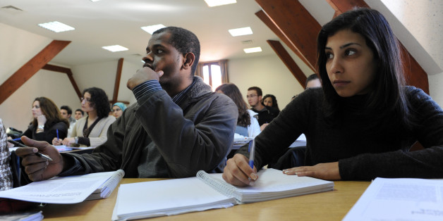 TO GO WITH AFP STORY IN FRENCH BY HERVE GUILBAUD -  Students attend a class on the Campus of al Akhawayn Ifrane University on January 29, 2009 in Ifrane. The private university, inaugurated in 1995 and located at 1600 metres above sea level in the central Atlas mountains, boasts immaculate grounds and ultra moden facilities for some 1300 students from around the world who on average part with 10,000 euros a year for tuition fees. Youssra Benchrif head of external communications for the universit