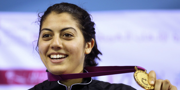Tunisia's Azza Besbes poses after winning the gold medal for the women's individual sabre fencing final during the Arab Games in Doha December 18, 2011.  REUTERS/Mohammed Dabbous (QATAR - Tags: SPORT FENCING)