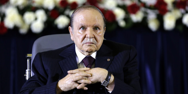 President Abdelaziz Bouteflika looks on during a swearing-in ceremony in Algiers April 28, 2014. Bouteflika was sworn in for a fourth term on Monday after easily winning an election opponents dismissed as fraudulent to re-appoint the ailing independence veteran after 15 years in power.  REUTERS/Louafi Larbi (ALGERIA - Tags: POLITICS ELECTIONS)