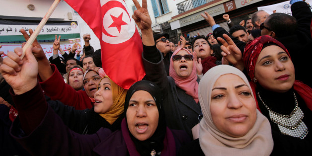 Women shout slogans during demonstrations on the seventh anniversary of the toppling of president Zine El-Abidine Ben Ali, in Tunis, Tunisia January 14, 2018. REUTERS/Youssef Boudlal
