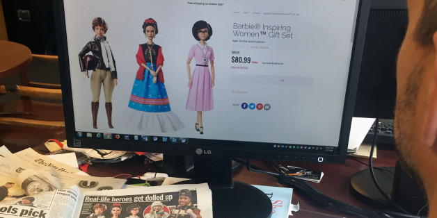 A journalist looks at the new series Barbie 'Inspiring Women', featuring (L-R) Amelia Earhart, Frida Kahlo and Katherine Johnson that honors three historic figures who each made a major mark on the world on March 7, 2018 in New York.Mexican artist Frida Kahlo, French chef Hélène Darroze or snowboarder Chloe Kim now have their Barbie, as well as a series of other famous women, unveiled March 7, 2018 by Mattel, who is trying a new marketing move to address the slowdown in sales. This week Ma